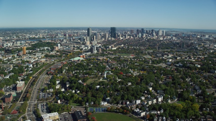 6K stock footage aerial video flying over Roxbury in autumn, approaching Downtown Boston, Massachusetts Aerial Stock Footage | AX142_016