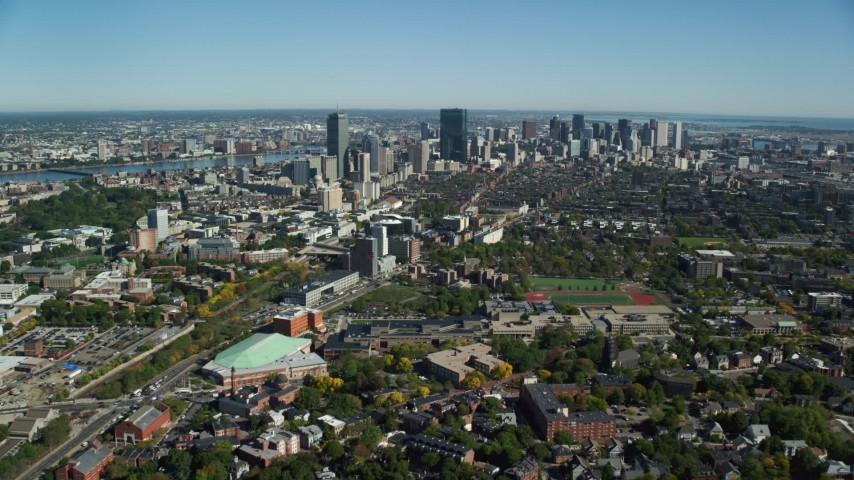 6K stock footage aerial video flying over Roxbury, approaching skyline, autumn, Downtown Boston, Massachusetts Aerial Stock Footage | AX142_017