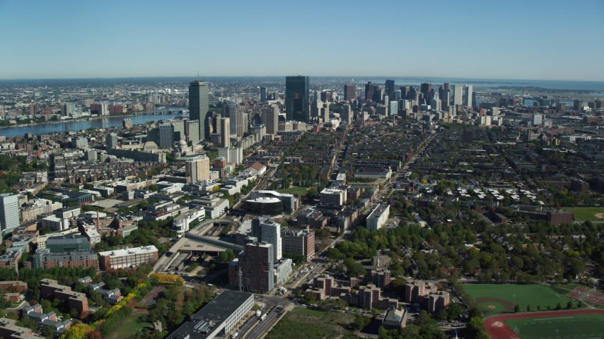 6K stock footage aerial video flying over buildings in autumn, approaching Downtown Boston, Massachusetts Aerial Stock Footage | AX142_018