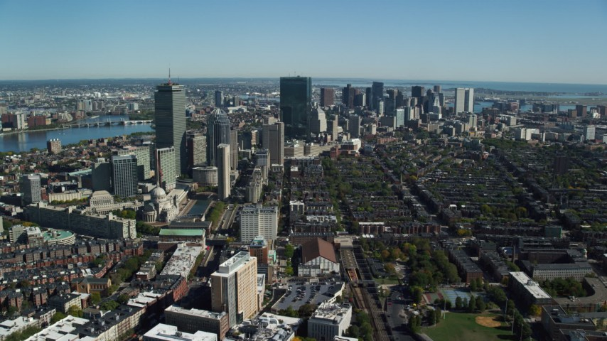 6K stock footage aerial video flying over buildings in autumn, approaching Downtown Boston, Massachusetts Aerial Stock Footage | AX142_019