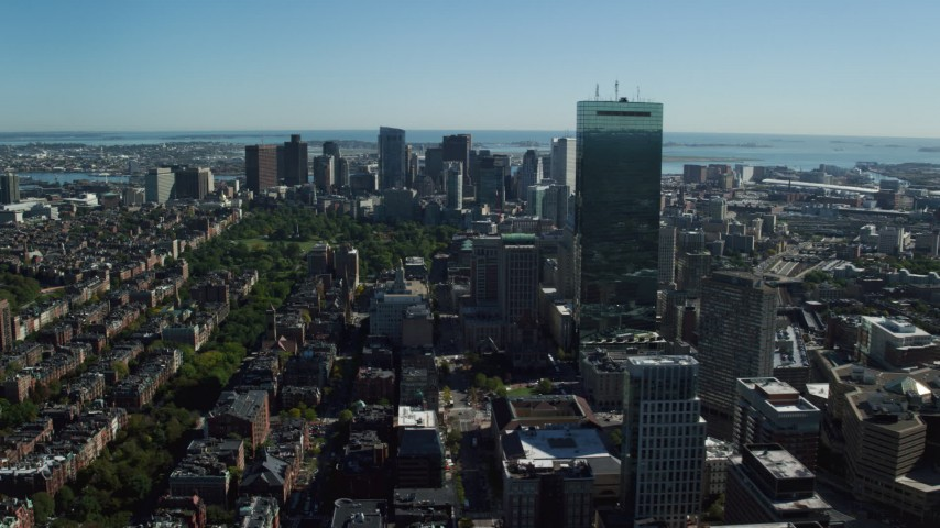 6K stock footage aerial video flying over buildings and by skyscrapers, Downtown Boston, Massachusetts Aerial Stock Footage | AX142_021