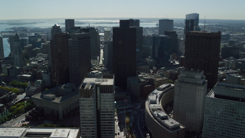 6K stock footage aerial video flying by skyscrapers, Boston City Hall, Downtown Boston, Massachusetts Aerial Stock Footage | AX142_025