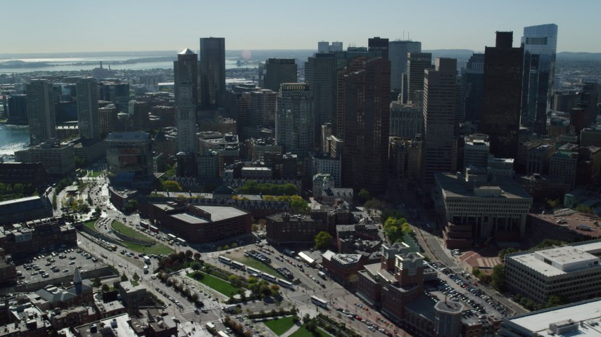 6K stock footage aerial video flying by skyscrapers, Boston City Hall, Downtown Boston, Massachusetts Aerial Stock Footage | AX142_026