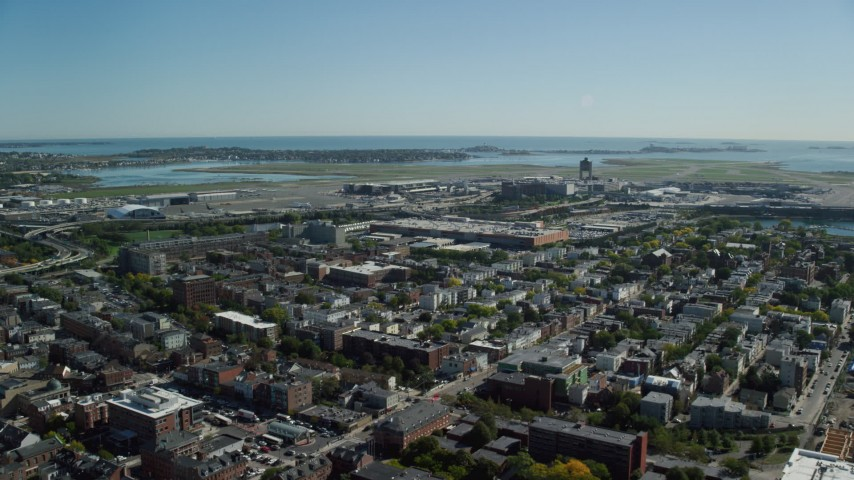 6K stock footage aerial video approaching, flying over Logan International Airport, East Boston, Massachusetts Aerial Stock Footage | AX142_027