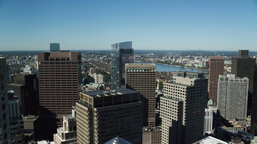 6K stock footage aerial video of One and Two International Place, reveal Millennium Tower, Downtown Boston, Massachusetts Aerial Stock Footage | AX142_038