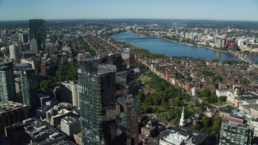 6K stock footage aerial video of Millennium Tower, reveal Boston Common, Downtown Boston, Massachusetts Aerial Stock Footage | AX142_039