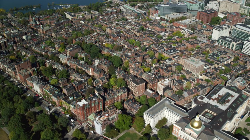 6K stock footage aerial video of Massachusetts State House, Beacon Hill, Downtown Boston, Massachusetts Aerial Stock Footage | AX142_040