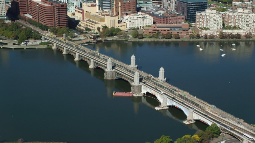 6K stock footage aerial video flying by the Longfellow Bridge spanning the Charles River, Boston, Massachusetts Aerial Stock Footage | AX142_041