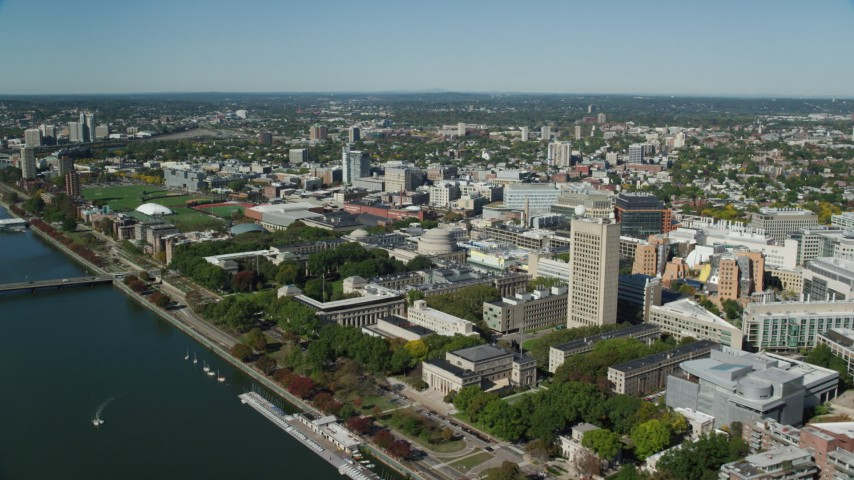 6K aerial video approaching Massachusetts Institute of Technology (MIT), Cambridge, Massachusetts Aerial Stock Footage | AX142_042