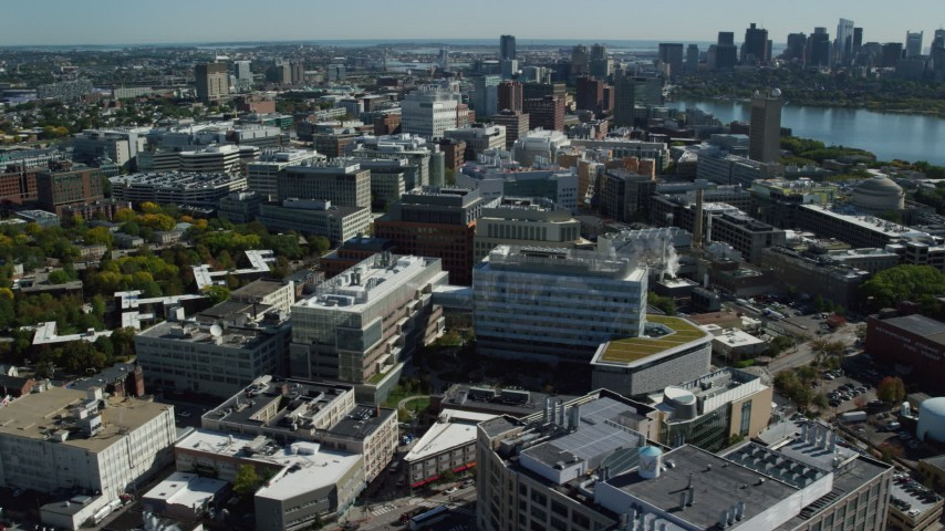 6K stock footage aerial video flying by MIT, revealing Downtown Boston skyline, Cambridge, Massachusetts Aerial Stock Footage | AX142_046