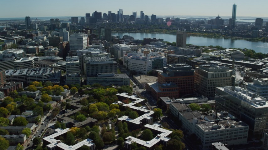 6K stock footage aerial video of office buildings, Main Street, Downtown Boston skyline, Cambridge, Massachusetts Aerial Stock Footage | AX142_047