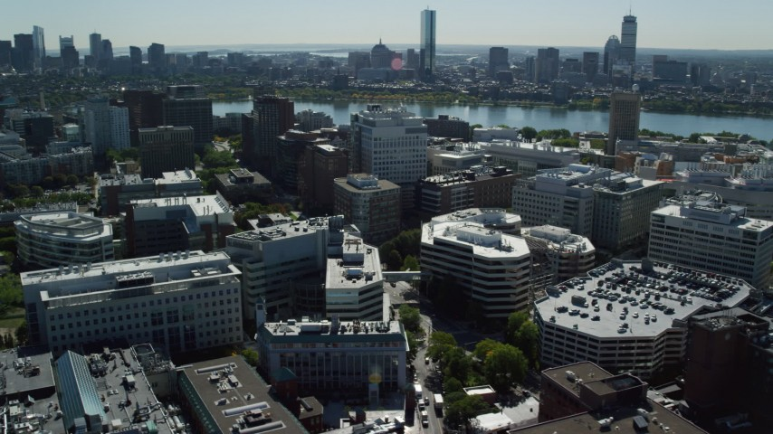6K stock footage aerial video flying by office buildings, Downtown Boston skyline, Cambridge, Massachusetts Aerial Stock Footage | AX142_048
