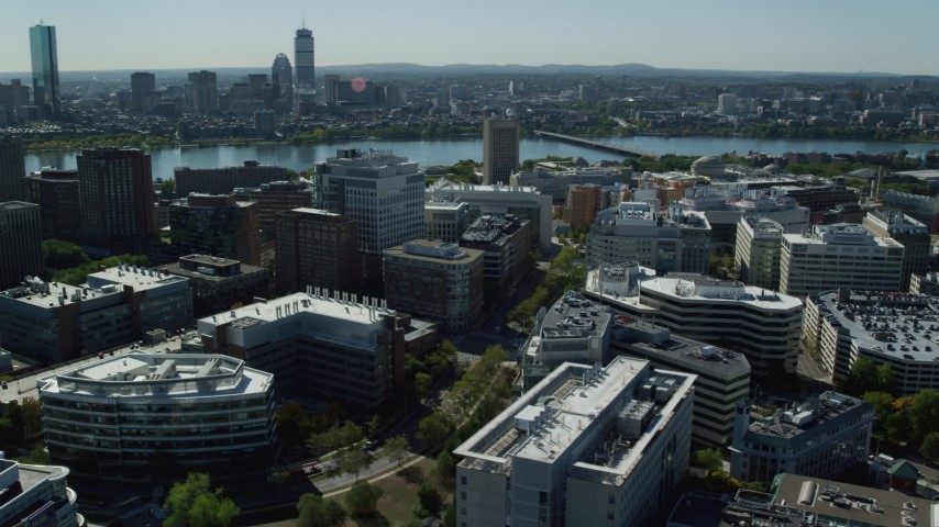 6K stock footage aerial video flying by office buildings, Charles River, Cambridge, Massachusetts Aerial Stock Footage | AX142_049