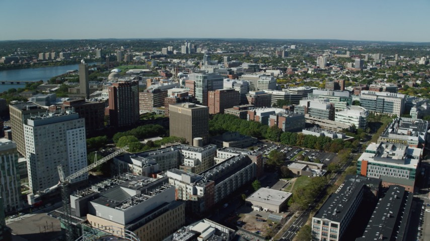 6K stock footage aerial video flying by office buildings, large crane, Cambridge, Massachusetts Aerial Stock Footage | AX142_051