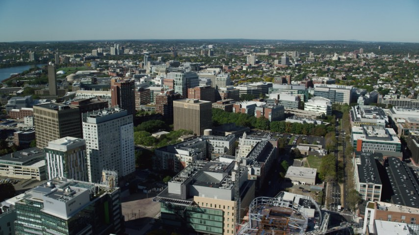 6K stock footage aerial video flying by office buildings, large crane, city streets, Cambridge, Massachusetts Aerial Stock Footage | AX142_052
