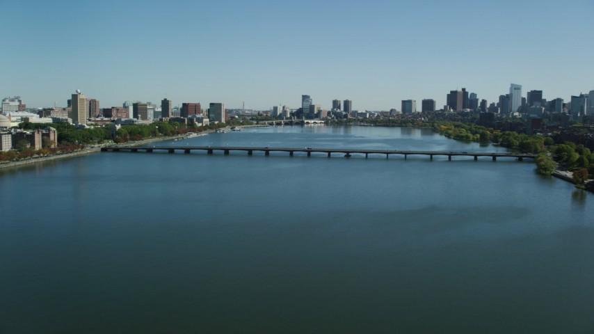 6K stock footage aerial video flying over Charles River, approaching Harvard Bridge, MIT, Cambridge, Massachusetts Aerial Stock Footage   AX142_058