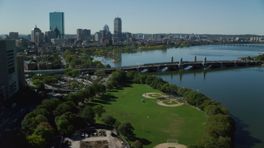 6K stock footage aerial video flying by Lederman Park, Longfellow Bridge, Downtown Boston, Massachusetts Aerial Stock Footage | AX142_067
