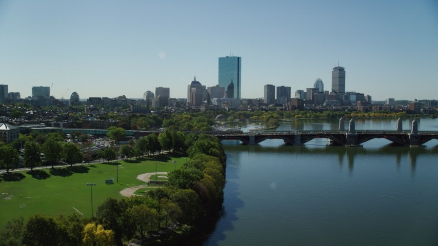 6K stock footage aerial video flying by Lederman Park, Longfellow Bridge, Downtown Boston, Massachusetts Aerial Stock Footage | AX142_068