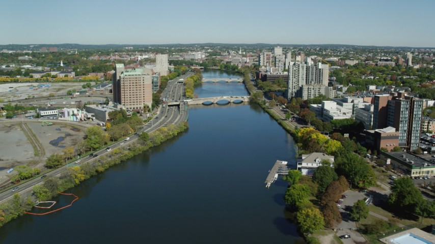 6K stock footage aerial video flying over Charles River, approaching bridges, Cambridge, Massachusetts Aerial Stock Footage   AX142_077