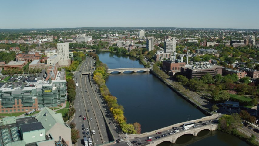 6K stock footage aerial video flying over Charles River, approaching bridges, Cambridge, Massachusetts Aerial Stock Footage   AX142_078