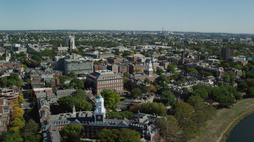 6K aerial video flying by Harvard University, Cambridge, Massachusetts Aerial Stock Footage | AX142_081