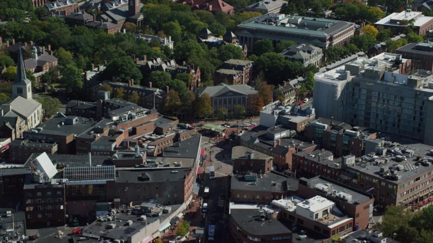 6K stock footage aerial video orbiting Harvard Square, Harvard University, Cambridge, Massachusetts Aerial Stock Footage | AX142_111
