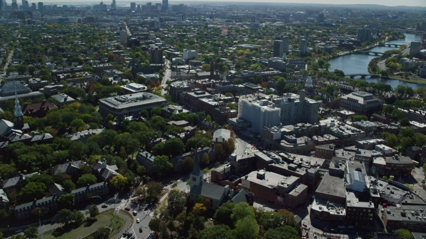 6K aerial video orbiting Harvard University, revealing Charles River, Cambridge, Massachusetts Aerial Stock Footage | AX142_113