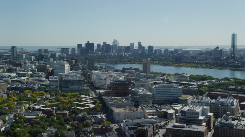6K stock footage aerial video flying over MIT, by the skyline, Downtown Boston, Massachusetts Aerial Stock Footage | AX142_125