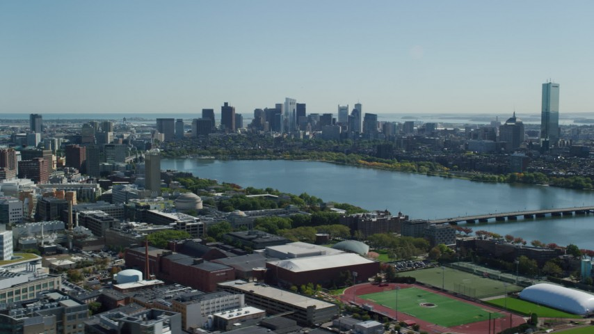 6K stock footage aerial video flying by skyline from over MIT, Downtown Boston, Massachusetts Aerial Stock Footage | AX142_126