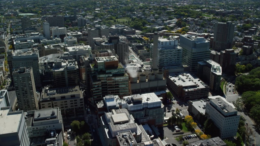 6K stock footage aerial video flying by Longwood Medical Area, approaching power plant, Boston, Massachusetts Aerial Stock Footage | AX142_137