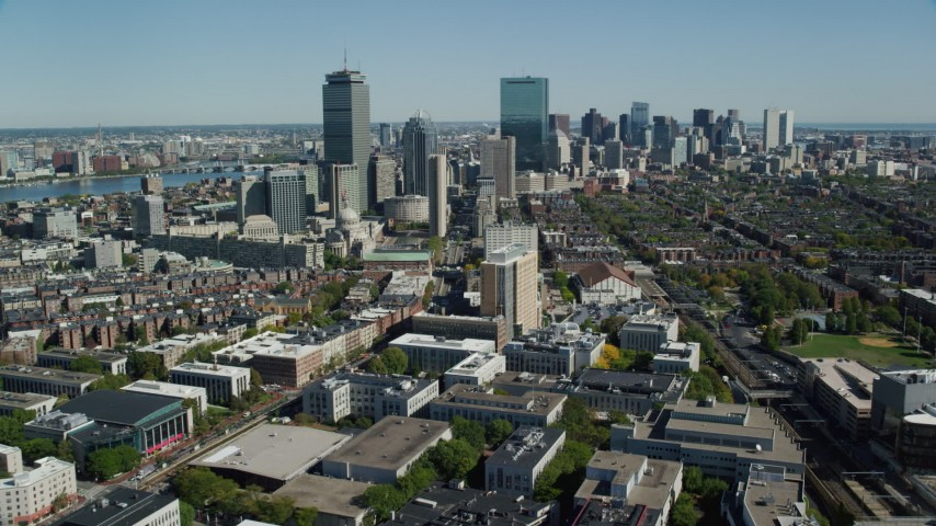 6K stock footage aerial video flying over buildings, approaching skyscrapers, Downtown Boston, Massachusetts Aerial Stock Footage | AX142_147