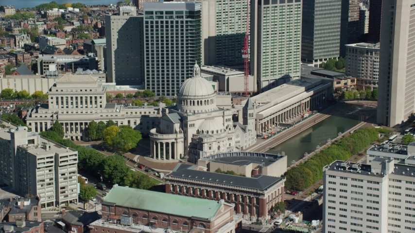 6K stock footage aerial video flying by First Church of Christ Scientist, Downtown Boston, Massachusetts Aerial Stock Footage | AX142_148