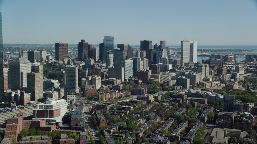 6K stock footage aerial video flying by buildings and skyscrapers, Downtown Boston, Massachusetts Aerial Stock Footage | AX142_149