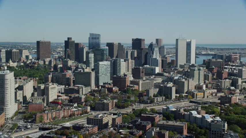 6K stock footage aerial video flying by buildings and skyscrapers, Downtown Boston, Massachusetts Aerial Stock Footage | AX142_150