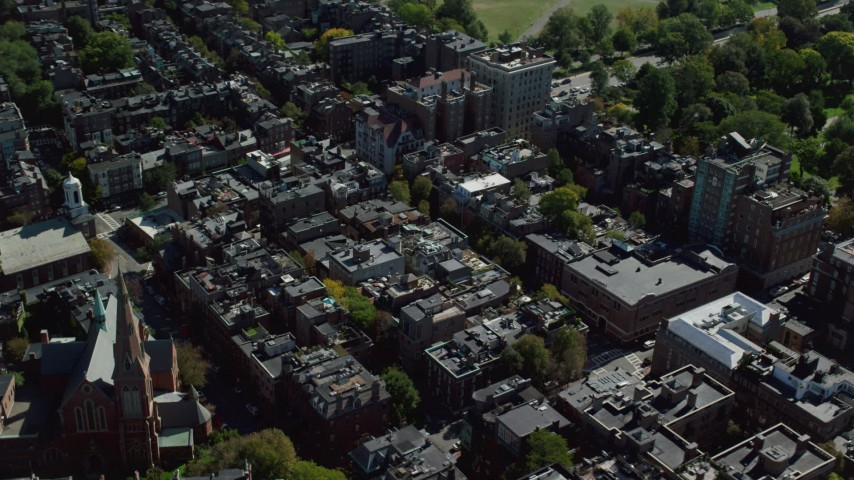 6K stock footage aerial video flying over row houses, tilt down, Beacon Hill, Downtown Boston, Massachusetts Aerial Stock Footage | AX142_155