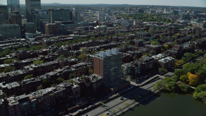 6K stock footage aerial video flying by Victorian brownstones, pan left, Back Bay, Downtown Boston, Massachusetts Aerial Stock Footage | AX142_159