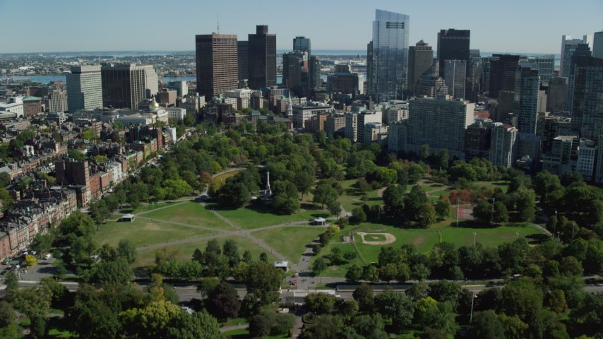 6K stock footage aerial video flying over Boston Common, approaching Downtown Boston, Massachusetts Aerial Stock Footage | AX142_166