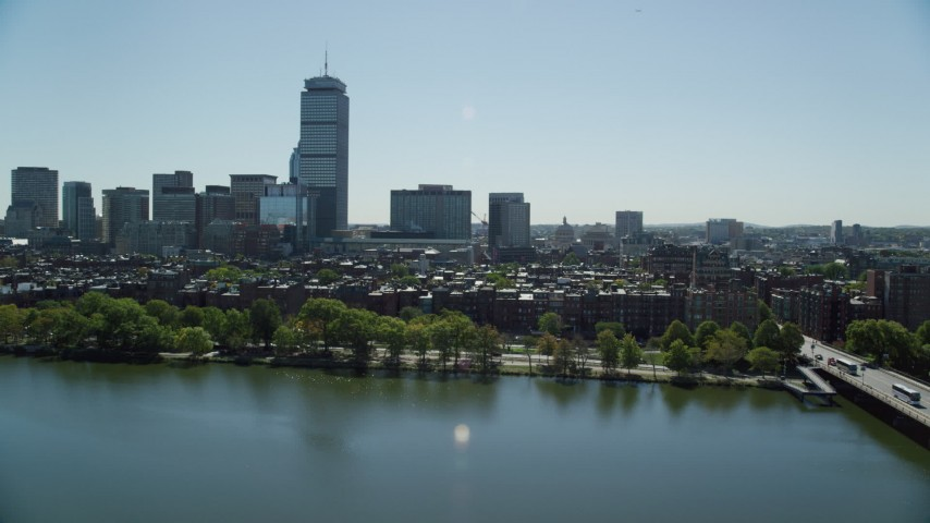 6K stock footage aerial video approaching buildings and parks, Back Bay, Downtown Boston, Massachusetts Aerial Stock Footage | AX142_171