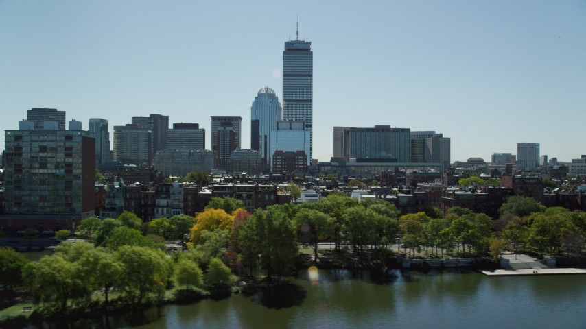 6K stock footage aerial video flying by buildings and parks, Back Bay, Downtown Boston, Massachusetts Aerial Stock Footage | AX142_172