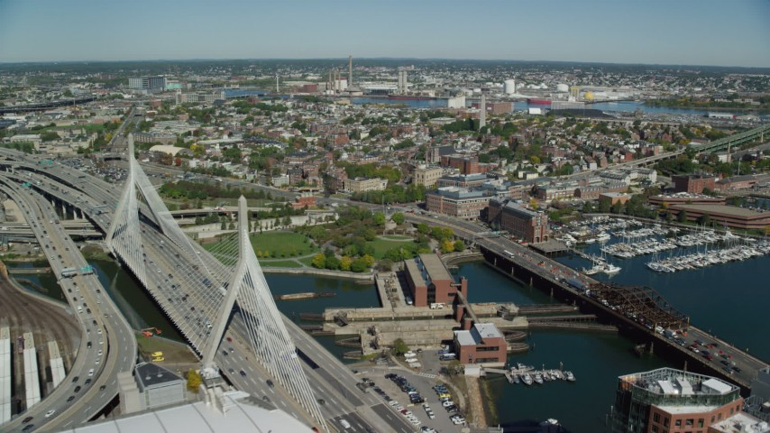 6K stock footage aerial video flying over TD Garden, Zakim Bridge, Charlestown Bridge, Charlestown, Massachusetts Aerial Stock Footage | AX142_177