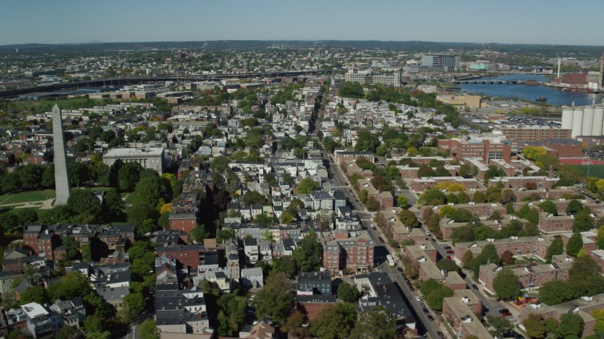 6K stock footage aerial video orbiting Bunker Hill Monument, apartments, row houses, Charlestown, Massachusetts Aerial Stock Footage | AX142_179
