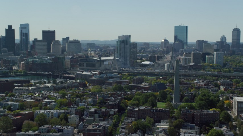 6K stock footage aerial video of Bunker Hill Monument, Downtown Boston skyline, Charlestown, Massachusetts Aerial Stock Footage | AX142_180