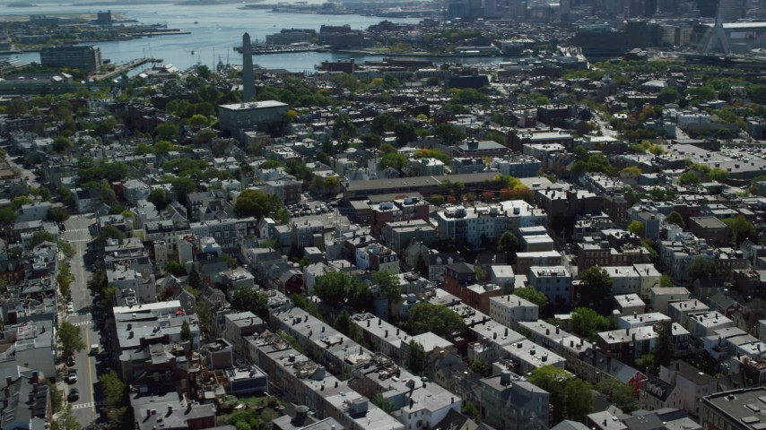 6K stock footage aerial video flying by Bunker Hill Monument, row houses, Charlestown, Massachusetts Aerial Stock Footage   AX142_182
