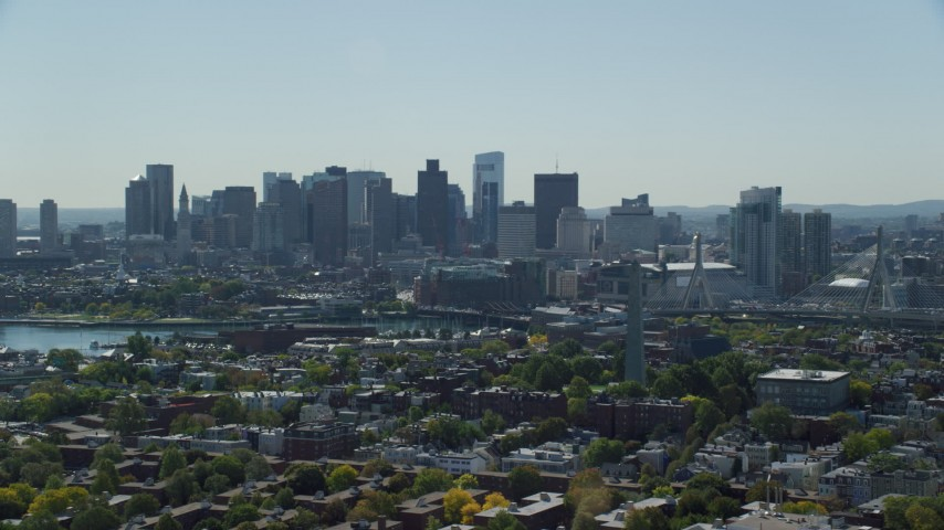 6K stock footage aerial video of Bunker Hill Monument, Downtown Boston skyline, Charlestown, Massachusetts Aerial Stock Footage | AX142_186