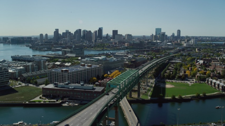 6K stock footage aerial video of Tobin Memorial Bridge, Downtown Boston skyline, Charlestown, Massachusetts Aerial Stock Footage | AX142_188