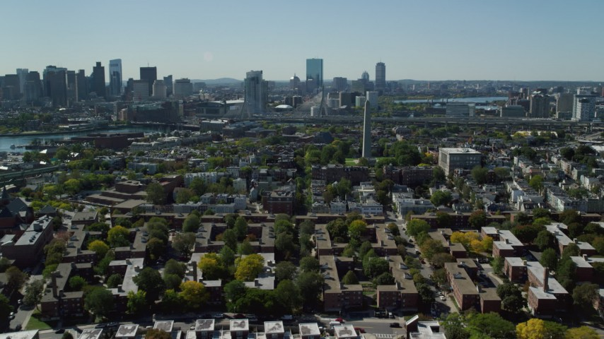 6K stock footage aerial video flying by Bunker Hill Monument, apartments, houses, Charlestown, Massachusetts Aerial Stock Footage | AX142_194
