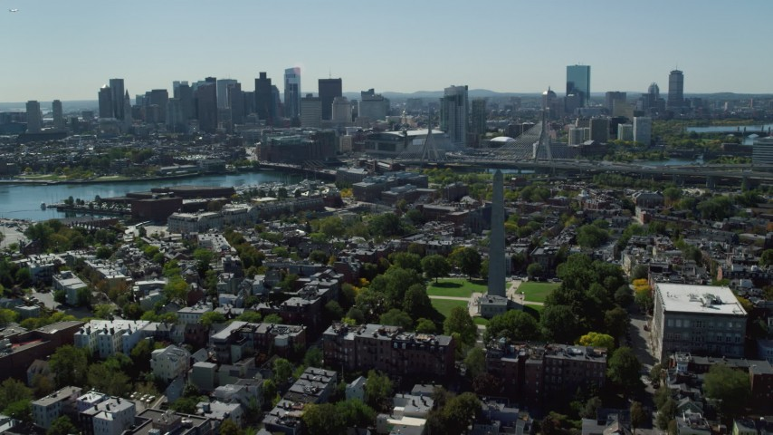 6K stock footage aerial video over Bunker Hill Monument toward Downtown skyline, Charlestown, Massachusetts Aerial Stock Footage | AX142_195