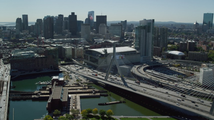 6K stock footage aerial video flying over Zakim Bridge, approach TD Garden, Downtown Boston, Massachusetts Aerial Stock Footage | AX142_197