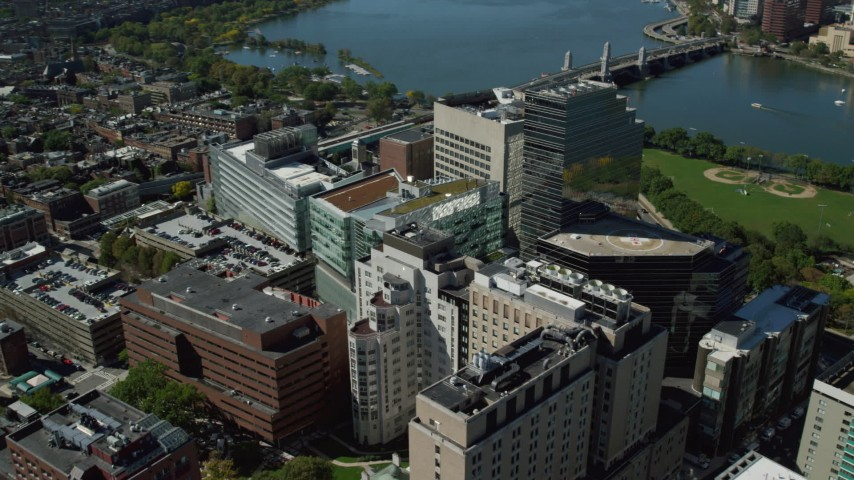 6K stock footage aerial video flying by Massachusetts General Hospital, tilt down, West End, Downtown Boston, Massachusetts Aerial Stock Footage | AX142_199