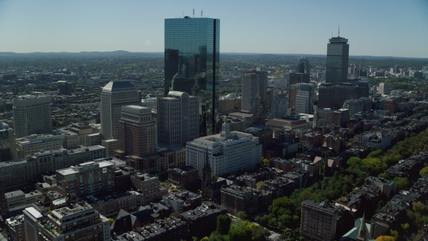 6K stock footage aerial video approaching skyscrapers and buildings, Downtown Boston, Massachusetts Aerial Stock Footage | AX142_201